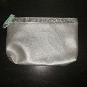 Silver Ipsy Bag With Glitter Top